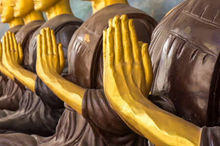follower: Buddhist follower statue in Thailand Stock Photo