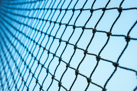 black rope net with blue background