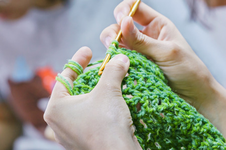 someone is making crochet photo