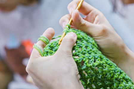 someone is making crochet