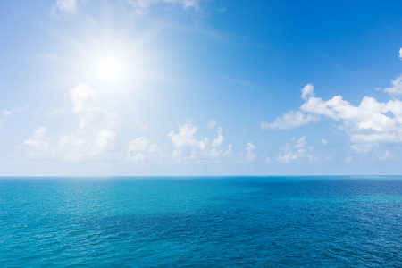 sea scape with cloud and sun in the blue sky. this image suitable to traveling advertisement or nature.