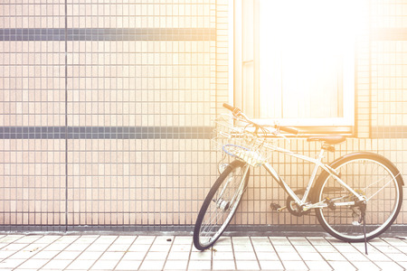 bicycle near the wall with the sun among the window Stok Fotoğraf