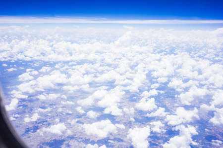 above: above the cloud in the sky from a plane.