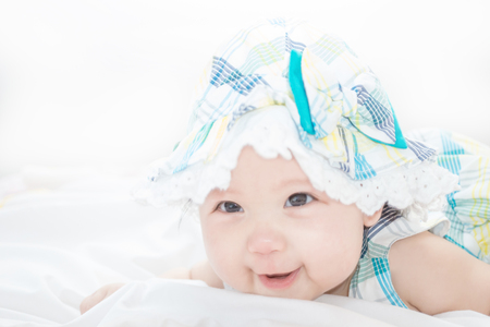 a baby is just chest up in the first time and interesting in something with smile with copy space Stok Fotoğraf