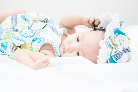 a baby lay down on her bed and feel uncomfortable Stok Fotoğraf