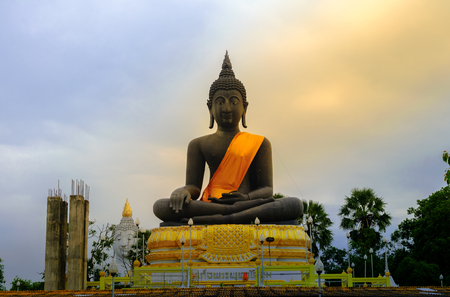 devote: Black buddha statue attitude of meditation, buddha against background sky in Thailand