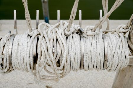 Rope knot on boat sea background as a strong nautical marine line tied together as a symbol for trust and faith and a metaphor for strength or stress.