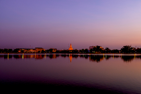 Phra Pathom Chedi Sanctuary is a vital part of Thailand, water reflag sunset twilight Stock Photo