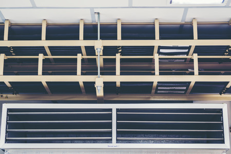 Cable tray with electrical wiring arranged on ceiling ,Cable tray epoxy dark grey : Houses runs of control and power cable used for cable and wire junction distribution and termination. Stock Photo