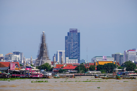 BANGKOK, THAILAND - 2 JUN 2017, Standing on the Chao Phraya river Viwe point to Wat Arun (Temple of Dawn) repare pagoda sacred sanctuary