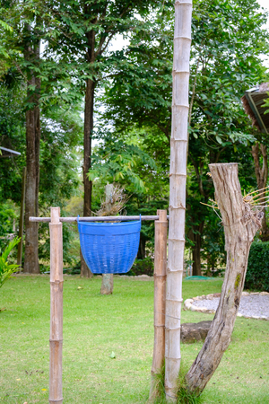 recycle bin in garden with bamboo tower