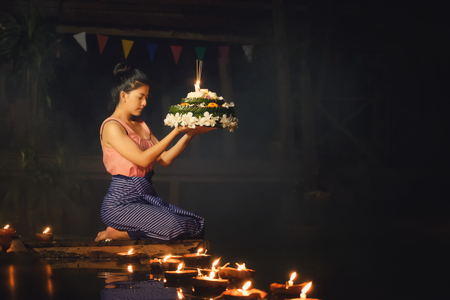 Loy Krathong Traditional Festival, Thai woman hold kratong, Thailand, Asia woman in Thai dress traditional hold kratong and bring Krathong to float in Loi kratong day of Thailand. Stock Photo