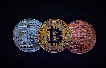 Stack of glod bitcoins with a single coin facing the camera in B sharp focus, Cryptocurrency concept. Virtual currency digital payment system Stock Photo