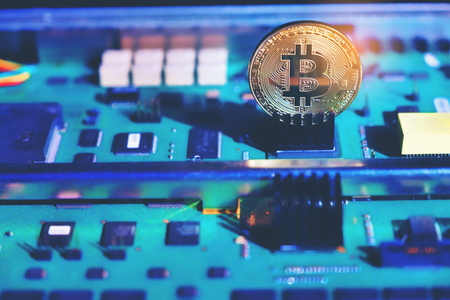 abstract image Golden Bitcoin money on mainboard computer surface background