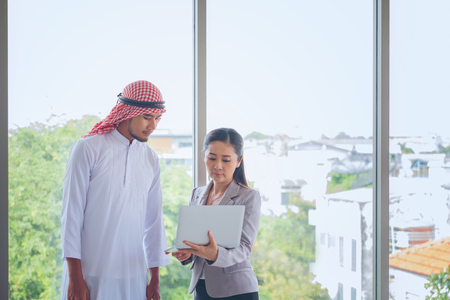 Businessp man Arab eople With Digital Tablet In Office, People Meeting Discussion Working Office Concept, Attractive business couple using tablet in their company