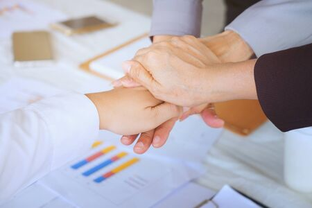 Business men making handshake, Partnership congratulation, merger and acquisition concepts, Vintage tone Retro filter effect, soft focus, office background. Stock Photo