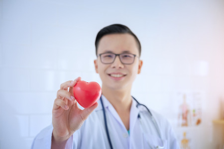 Heart in the hands of the doctor who mediates health. Love concept. Health concept. selective focus blur doctor