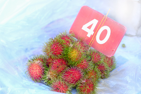 Rambutan sweet delicious fruit fruit 40 Thai baht per kilogram on white background in local market Asia