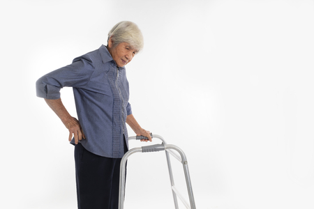 Senior Woman With Walking Frame has have a backache Stock Photo