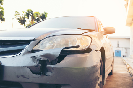 Front side of accident car. Car crash accident damaged automobiles after collision in city,  insurance, Stock Photo - 117124346