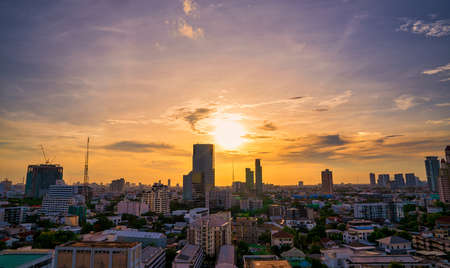 BANGKOK, THAILAND - MAY 19, 2020: Sunset reflects off skyscrappers in downtown bangkok Editorial