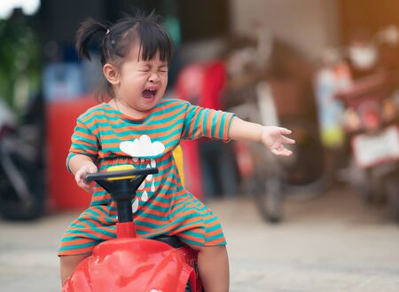girl child crying outdoors near the playground