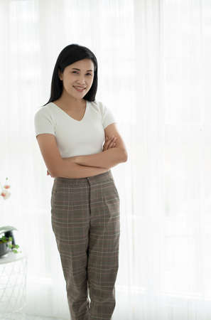 Young friendly Asian woman with smiley face Stock Photo