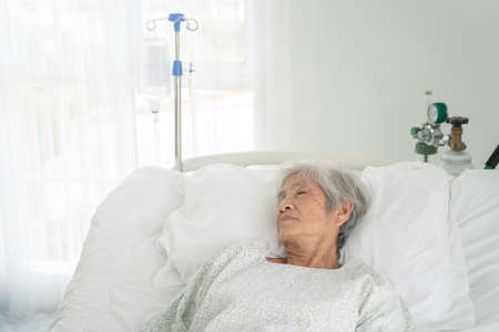 close up of patient grandfather in hospital bed