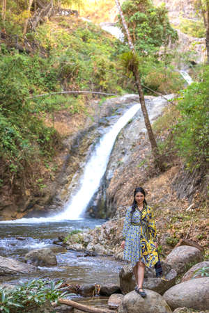 Thai woman traveler travel into amazing beautiful  in tropical forest 写真素材