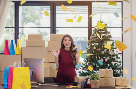 Successful Woman Entrepreneur With Parcel Boxes In Her Own Job Shopping Online Business At Home, Surprised Winner Winning Online