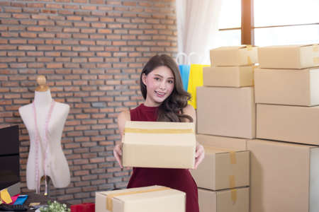 businesswoman working business entrepreneur SME at home with internet online sending a package