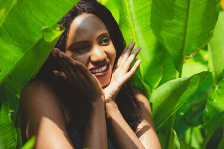 Green Tropical shoot of african american beauty.