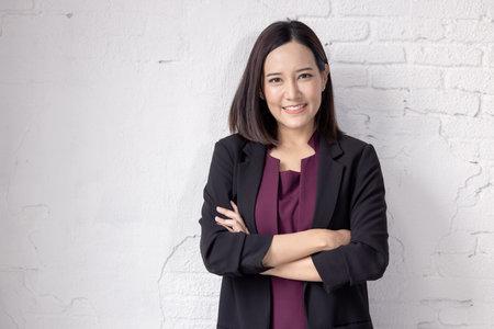 Happy portrait of a beautiful businesswoman smiling and Success. 版權商用圖片