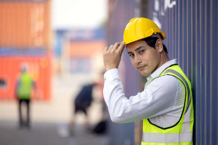 Portrait of proud engineer in protective workwear standing in a shipping yard 版權商用圖片 - 167519056