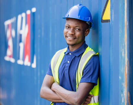 Portrait transportation man engineering a helmet logitics shipping at container background