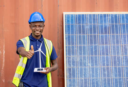African American Industrial, factory and energy engineer Specialist. Portrait black man engineering holding windmill model container and solar cell on background