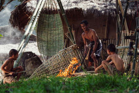 Thailand's father and son are making bamboo baskets or fishing gear by hand. Thailand's everyday life