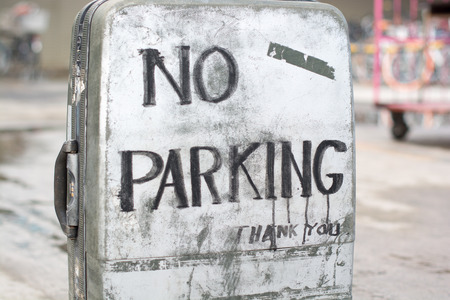 old suitcase: No parking sign on an old suitcase.