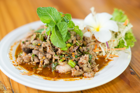 Spicy duck, Thailand food, local food, dishes, vegetables, frangipani, white, beautifully arranged plate of food put on the table, eat, hungry, delicious. Stock Photo