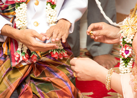 Bride, groom, wedding ring tied arms guests attended the wedding.