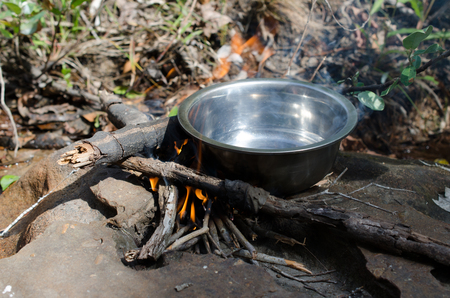 Boil water on the stove, firewood Wild coffee warm smell of smoke and flame beautiful. Stock Photo