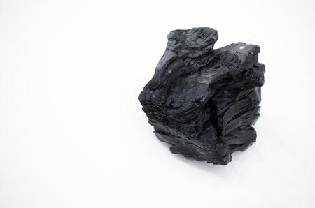 calorific: Pile of coal isolated on white background.