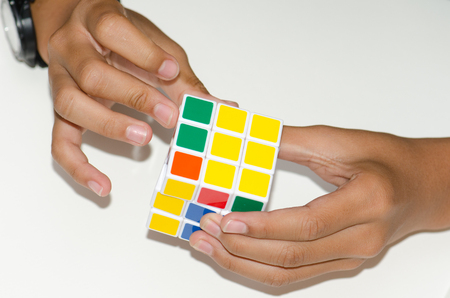 unsolved: Mobile Rubiks cube on a white background with expertise. And has many beautiful colors.