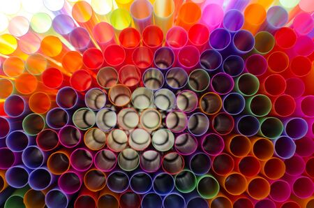 Plastic straw color. A light shone through a circular pipe. Took shape, beautiful colors Take a closer focus on the details clearly.