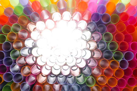 clearly: Plastic straw color. A light shone through a circular pipe. Took shape, beautiful colors Take a closer focus on the details clearly.