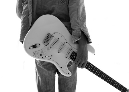 jamming: A young man with an electric guitar Leaning against a cement wall Happy and relaxed Waiting for the show.