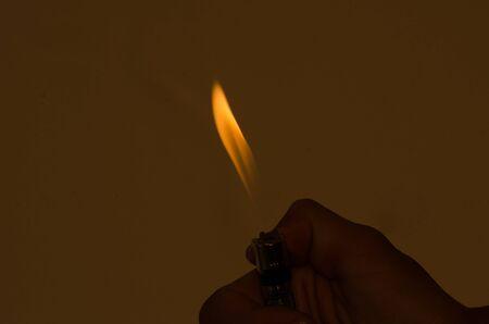 gas lighter: Mobile matches fire Make a beautiful flame, light orange light.