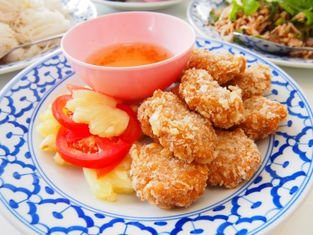 fired shrimp meat ball with sauce and fruit photo