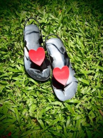 Heart Flip Flops on green grass, summer back  photo