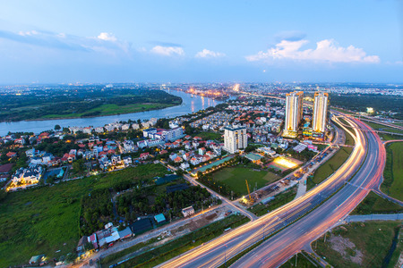 motobike: Ho Chi Minh City, Vietnam - November 16 2014 : Beautiful National Route 1A highway from high view at Ho Chi Minh City ( Sai Gon ) , Vietnam in sunset or sunrise